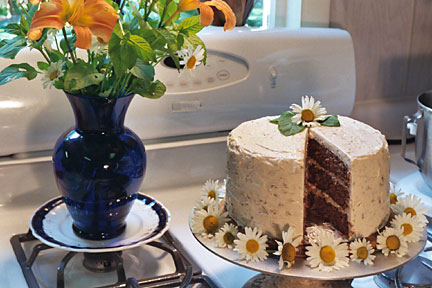 moist and delicious gourmet carrot cake with rich vanilla cream cheese-walnut icing for your wedding, birthday, or any special occasion!